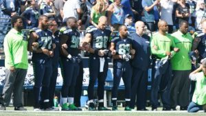 SEATTLE, WA - SEPTEMBER 11: Members of the Seattle Seahawks are seen together during the playing of the National Anthem before the start of an NFL game against the Miami Dolphins at CenturyLink Field on September 11, 2016 in Seattle, Washington. (Photo by Otto Greule Jr/Getty Images)