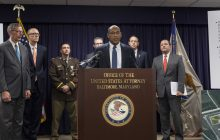 Guards and inmates charged in widespread bribery and smuggling operation