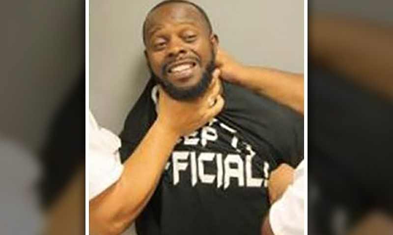 Man Who Wouldn't Stop Smiling During Mug Shot Suing Cops (Video)