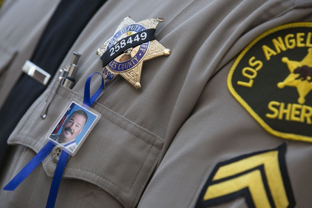 5 accused of helping suspect evade capture after killing of L.A. sheriff's sergeant