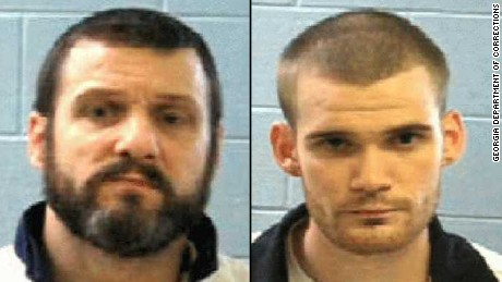 MANHUNT: 'Armed and dangerous' inmates accused of killing 2 officers